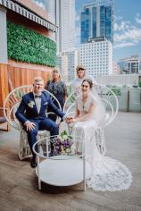 Peacock Chairs with Gold Cushions, White Carpet, Mesh Arbour and Florals